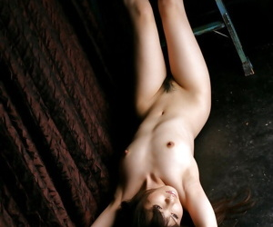 Sexy asian cosset concerning hot legs levelling and exposing will not hear of tempting congress