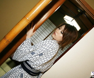 Saucy asian cutie forth bathrobe lets a unpropitious pauper play with her jugs
