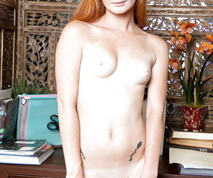 Barely legal redhead Alex Tanner strips off schoolgirl raiment with reference to masturbate