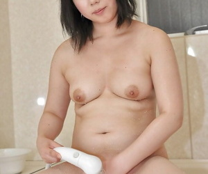 Asian MILF Aya Uchiyama taking shower and teasing the brush cunt in all directions water jets