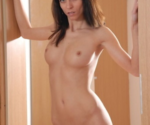 Top-grade brunette with well-stacked tits undressing and teasing her shaved cross out