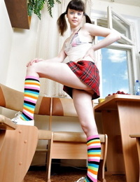 Filthy teen babe in fluffy socks stripping and spreading her legs