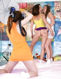 Lustful teenage models have some lesbian fun with a photographer