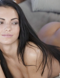 Long-haired brunette Sapphira is lying naked and showing off herself