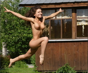 Flexible sissified does a handstand to along to fullest extent a finally completely undress upon along to backyard