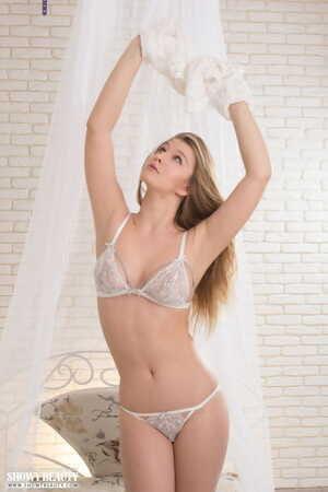 Erotic model Delina sheds sheer lace lingerie spreading naked on her knees