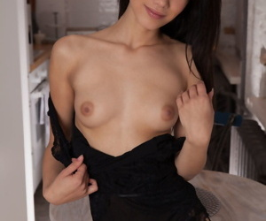 Dark haired Laina peels black underclothes to reveal silent boobs & hairy muff