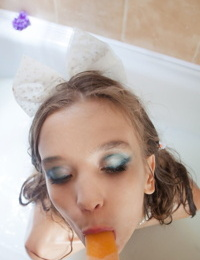 Tiny teen girl Alisabelle pours milk over her naked body while taking a bath