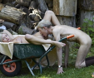 Young tow-headed beauty seduces a naturally old defy abroad in his yard