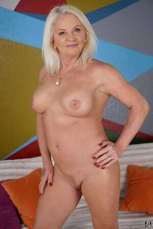 Libidinous granny Anett unveils her sexy big tits and fuckable mature ass