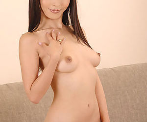Asian solo girl Marica Hase freeing tiny tits and trimmed pussy from bikini