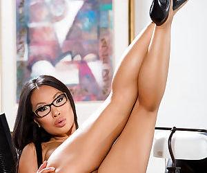 Glasses clad Asian solo girl Asa Akira unveiling spread pornstar pussy