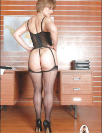 Mature fetish lady in stockings gets rid of her formal suit
