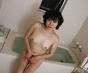 Asian milf Yoshiko Sakai takes a bath and demonstrates small tits