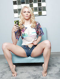 Blonde pornstar Allie Rae taking self shots while posing in denim shorts