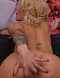 Tattooed blonde woman fingering her butthole and horny pussy