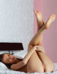 Skinny Euro playgirl Martha A strips to unveil her shaved muff