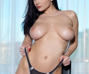 Erotic example Jenya D in ebony strap undressing to flaunt large love muffins & sweaty muff