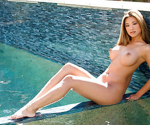 Smoking hot asian cutie with big jugs stripping by the pool
