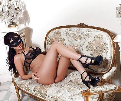 Big tit brunette babe Rachel undressing for a centerfold photos