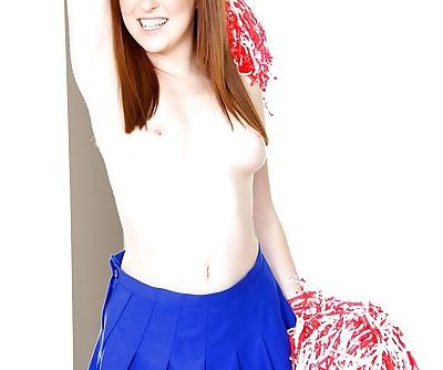 Cute redhead cheerleader Jessie Parker happily spreading her tight ass