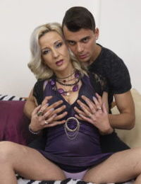 Older cougar gets frisky with a much younger man before they screw
