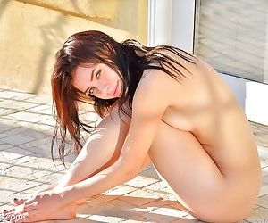 Hot skinny girl spreading wide open outdoors for huge vaginal insertion