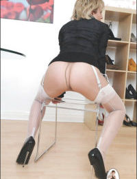 Lusty mature lady in stockings exposes her goods and plays with a big dildo