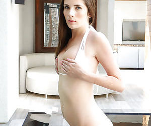 Young solo model Bella Skye demonstrating pink pussy and tight ass