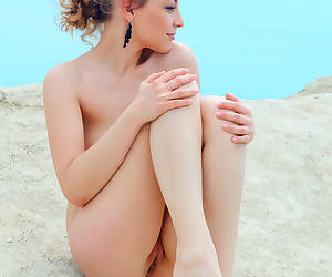European Nikia A posing naked toshow young tiny tits & sweet ass by the sea
