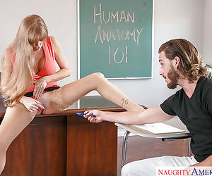Mature teacher Darla Crane giving her male student oral sex in classroom
