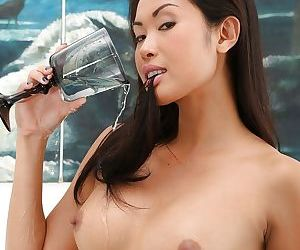 Asian fetish model Davon Kim drinking own pee after pissing into cup