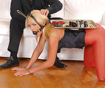 Leggy blonde in red pantyhose gagged and stuffed with anal beads