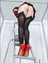 Hot ass mature lassie in stockings and miniskirt flashing her white panties