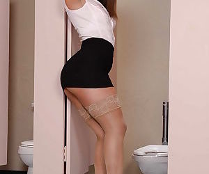Horny young brunette Abella Danger spreading her cunt in a bathroom