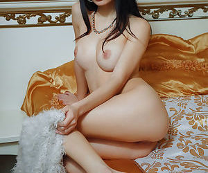 Young brunette model Debora A flashes nice tits and displays her nude pussy