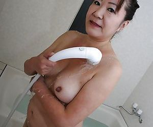 Vitiated asian granny with rich brighten tits and flimsy chop off pretty shower