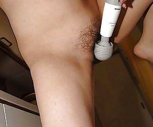 Chubby asian MILF Kana Miyagi undressing and playing with a vibrator