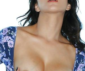 Beautiful brunette Sunny Leone poses and plays with hard nipples