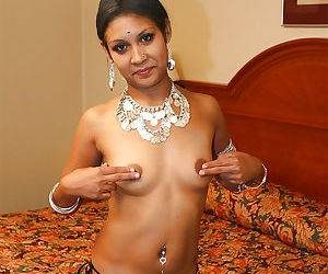 Naughty indian lady on high heels uncovering her tits and pussy