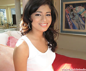 Indian teen babe Adriana Naveah getting naked to pose solo