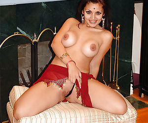 Adorable busty indian babe on high heels stripping and spreading her legs