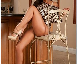 Indian MILF babe Priya Anjali Rai takes off lingerie to show her boobs