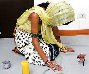 Indian solo model Tamara setting up candles for worship wit her clothes on