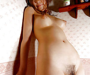 Lusty asian babe Reon Kosaka showcasing her petite tits and hairy cunt