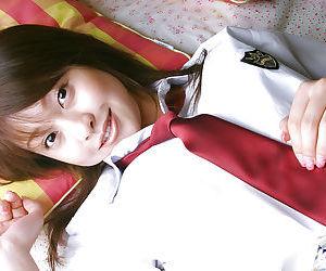 Naughty asian schoolgirl Ayumi Motomura slipping off her uniform