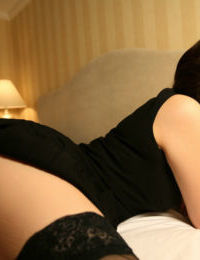 Gorgeous eastern adolescent in openwork nylons takes off her clothing and shorts