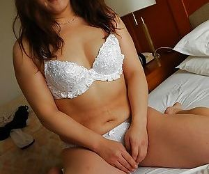 Asian grown-up daughter Keiko Chiba property naked and playing with her dealings toys