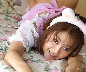 Asian maid Takane Hirayama revealing her tits and hairy cooter