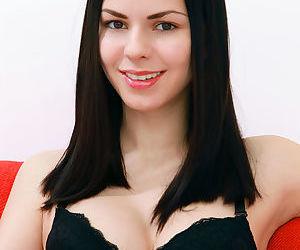 Dark haired Karolina Young in stockings showing nice tits & bald twat closeup